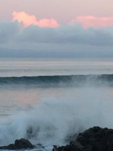 waves splashing in as the sun transforms